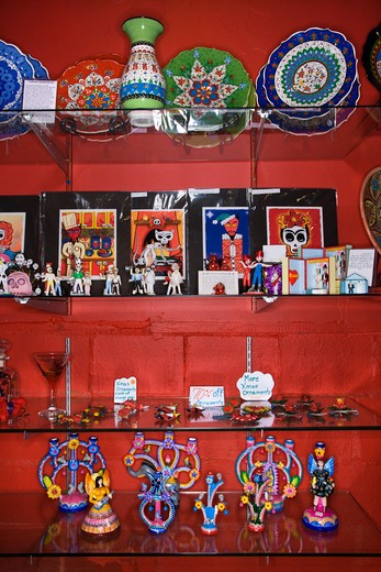 Shelves of unique folk art in retail store. : Stock Photo
