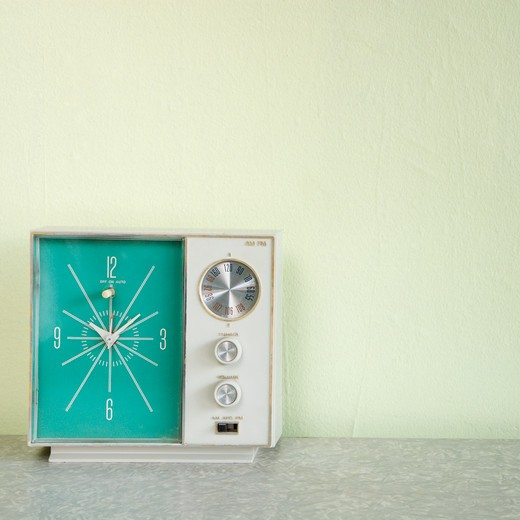 Still life of vintage clock radio with turquois face. : Stock Photo