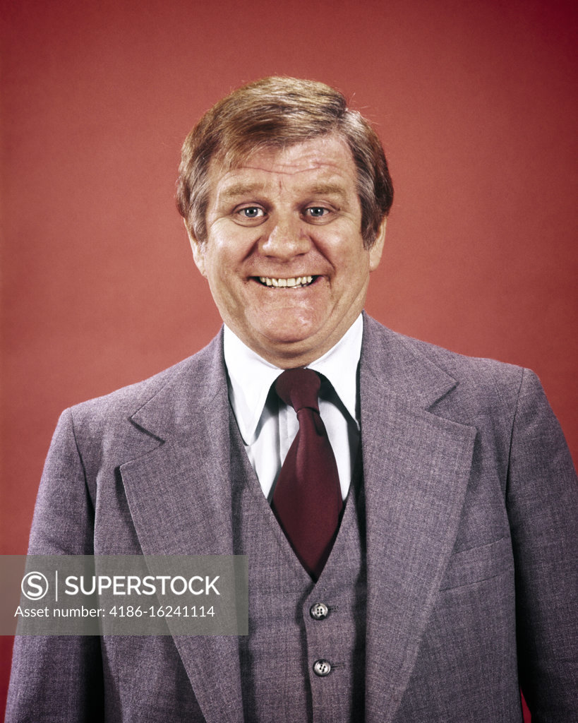 Stock Photo: 4186-16241114 1970s 1980s PORTRAIT GRIMACING PORTLY BUSINESSMAN WEARING THREE PIECE SUIT LOOKING AT CAMERA