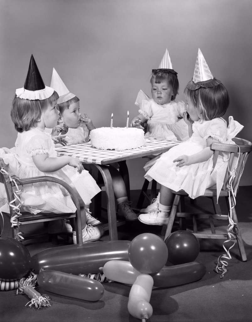 Stock Photo: 4186-1034 1960S Girl Quadruplets Having Second Birthday Party