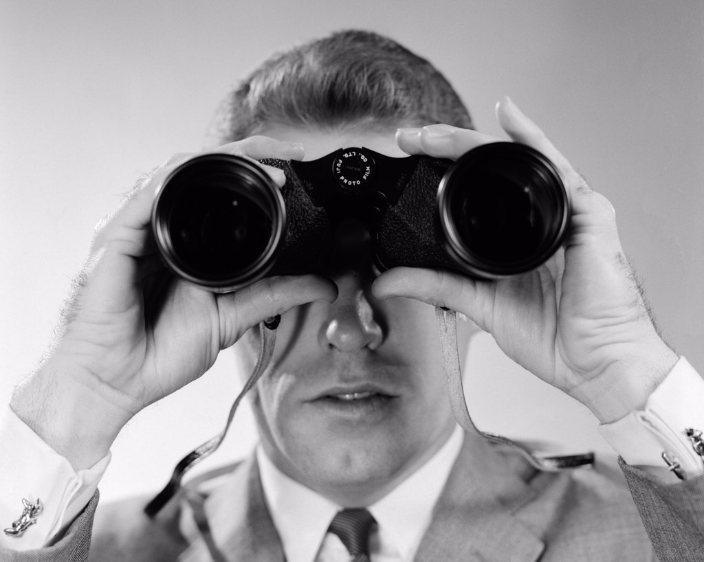 Stock Photo: 4186-1037 1960S Head-On Close-Up Of Man Looking Through Binoculars