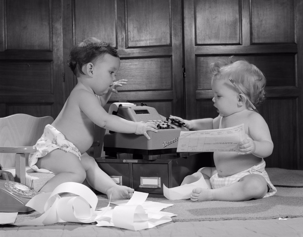 1960S Two Babies Wearing Diapers In Business Office With Adding Machine Playing Accountant : Stock Photo