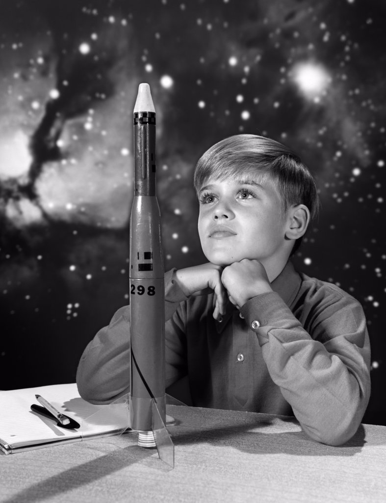 Stock Photo: 4186-1154 1960S Boy With Model Rocket And Outer Space Background