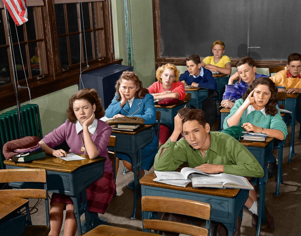 1940S 1950S High School Classroom Of Bored Students Sitting At Desks : Stock Photo