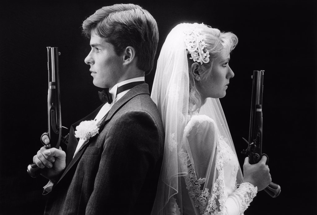 1980S Bride And Groom Back To Back Holding Dueling Pistols : Stock Photo