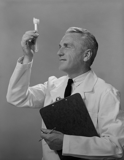 Stock Photo: 4186-12936 1960S Man Scientist Studying Test Tube