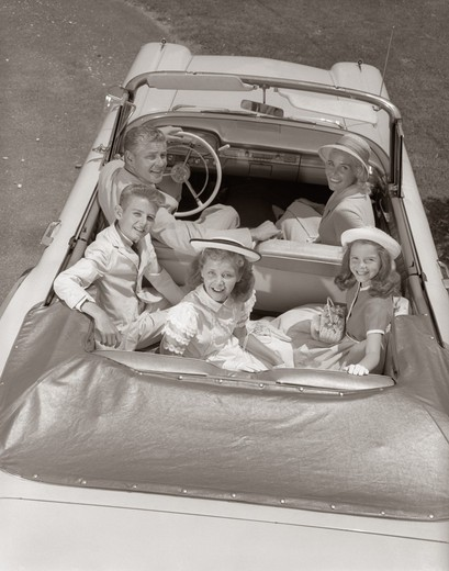 1950S Family Portrait Father Mother Son Two Daughters In Convertible Car Outdoor : Stock Photo
