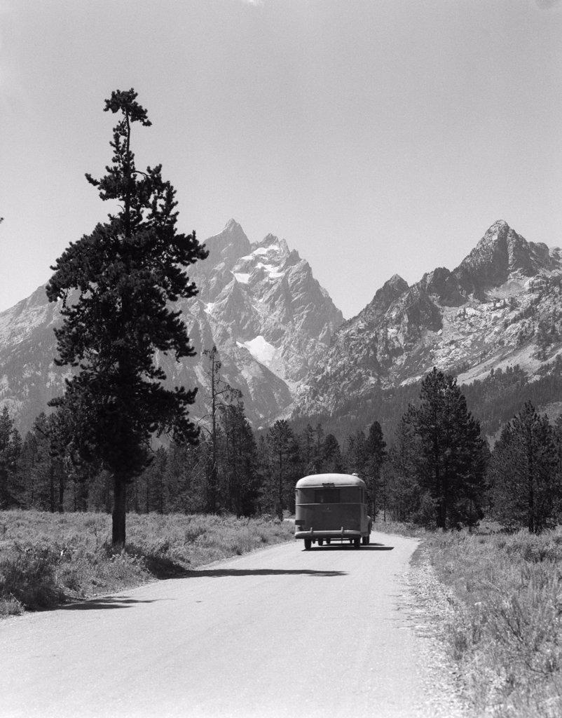 Stock Photo: 4186-13245 1940S Car Drive Grand Teton National Park Wyoming