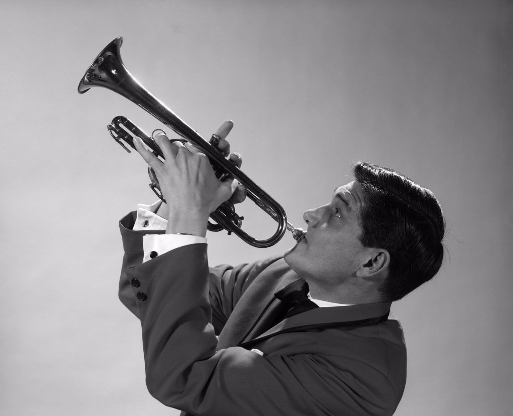 1960S 1970S Man Jazz Musician Playing Trumpet Solo : Stock Photo