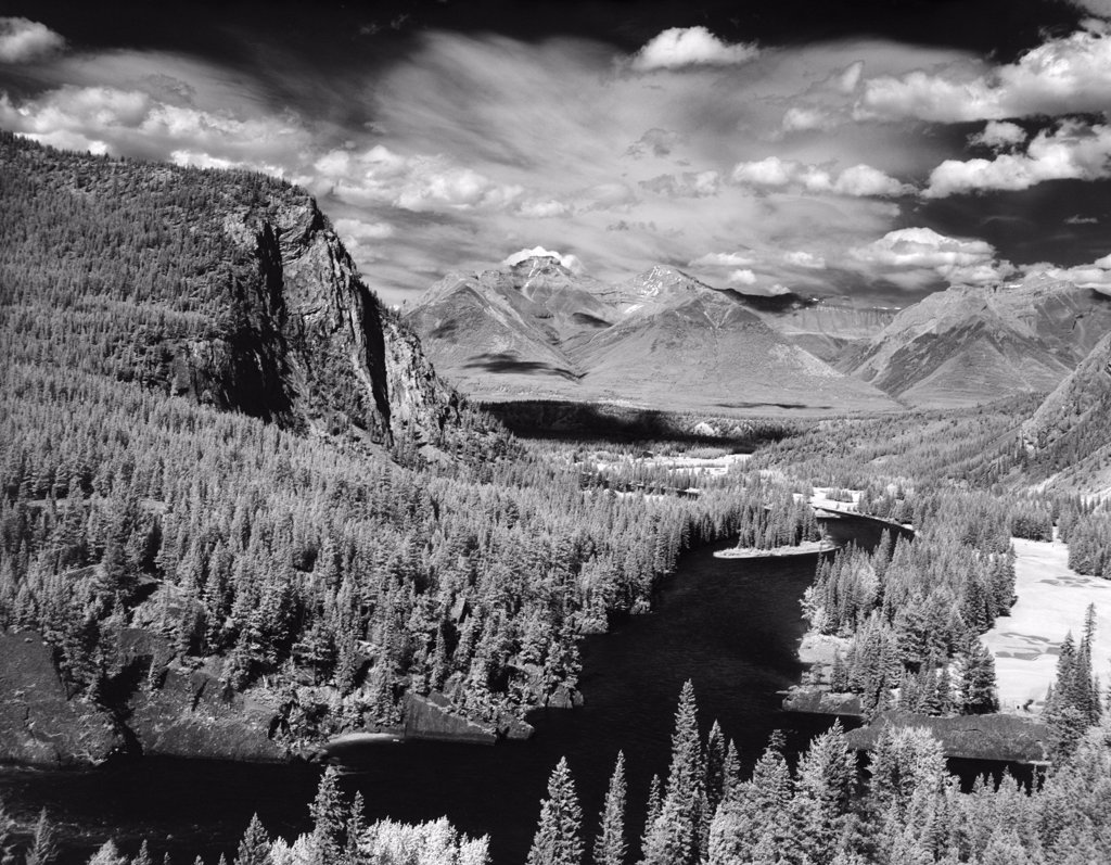1970S Bow River Valley Banff National Park Alberta Canada River Buried Between Mountains With Evergreen Trees : Stock Photo