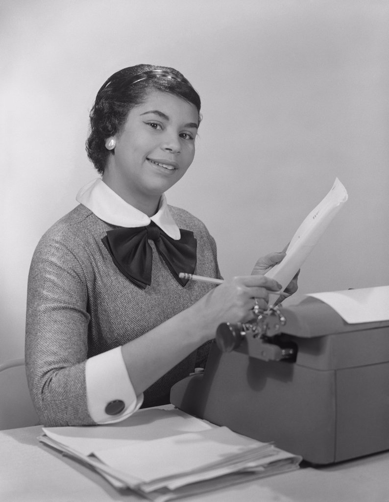 Stock Photo: 4186-13425 1950S Negro Woman Office Typewriter Secretary