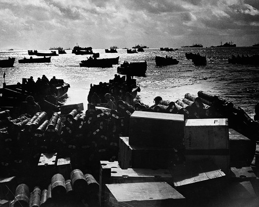 Stock Photo: 4186-13479 1940S World War Ii Dawn Dusk Coast Guard Landing Craft Crowding Shallow Invasion Waters Soldiers