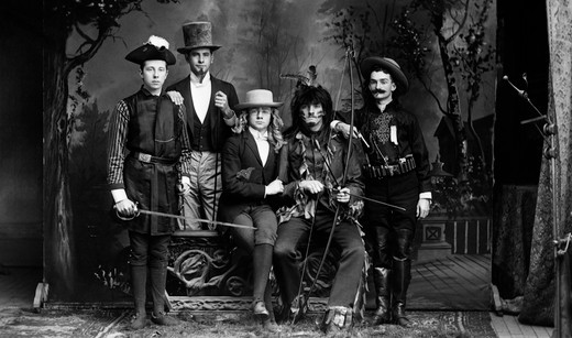 Stock Photo: 4186-13828 1890S Turn Of The Century Portrait Group Of Five Men Actors In Various Costumes Against Painted Studio Backdrop