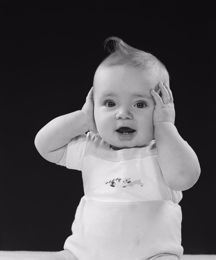 Stock Photo: 4186-1402 1950S Baby With Hands Up To Side Of Head Covering Ears
