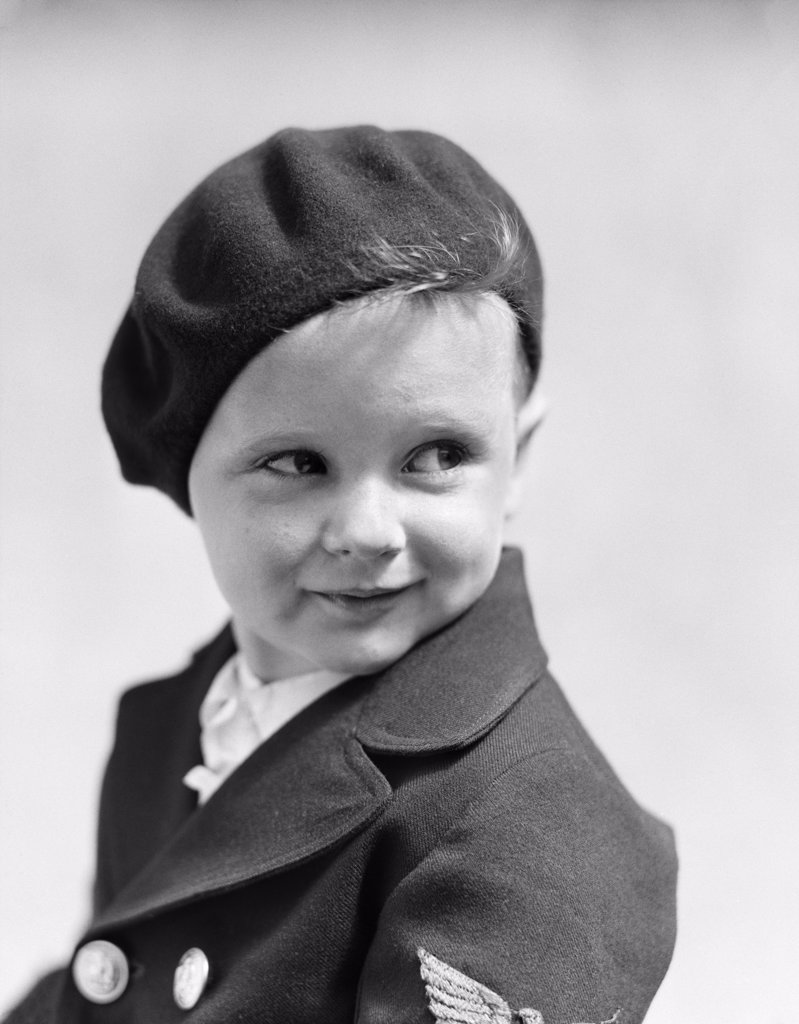 Stock Photo: 4186-14256 1930S Studio Portrait Of Young Boy Look To The Side Wearing A Beret And A Double Breasted Jacket