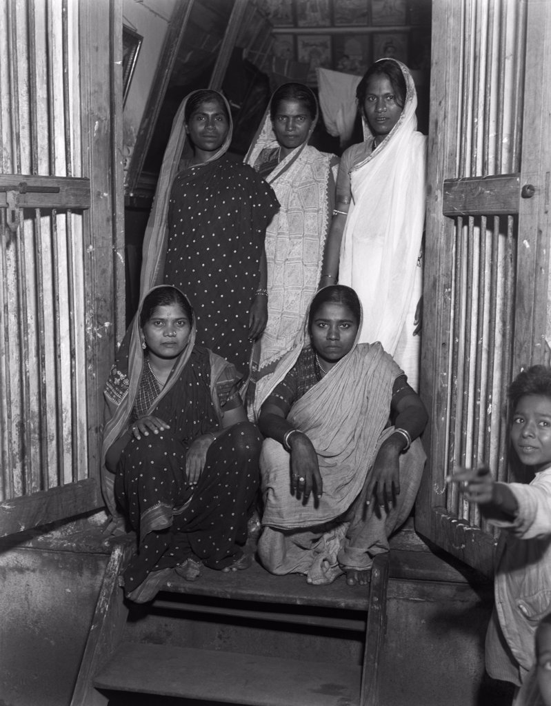 Stock Photo: 4186-14396 1930S Ladies Of Pleasure Grant Road Bombay India Women Prostitutes In Saris In Doorway