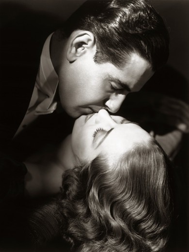 Stock Photo: 4186-1444 1930S 1940S Couple Man Woman Kissing Hollywood Movie Style