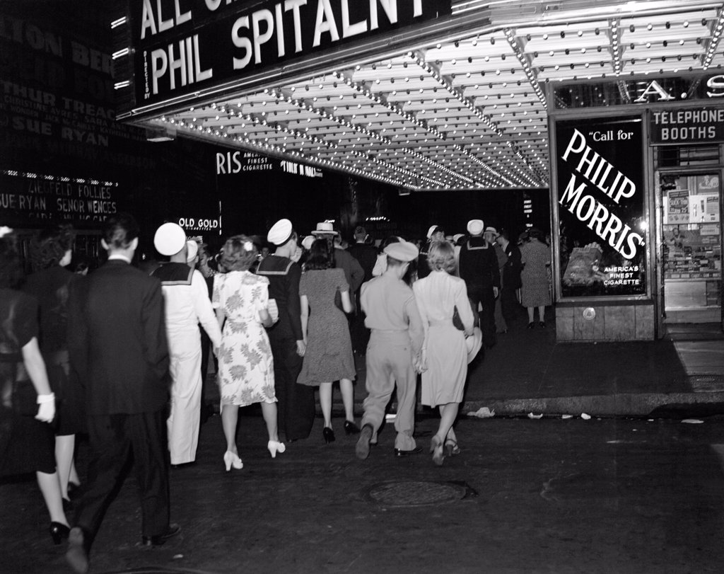 Stock Photo: 4186-14509 1940S Nyc Broadway At Night Marquee Of Movie Theater With Soldiers Sailors And Women On The Sidewalk Of West 51St Street New York City Usa