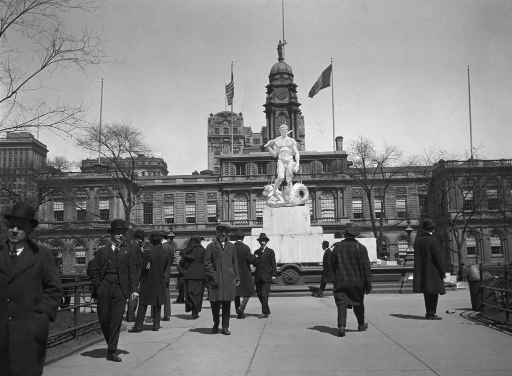 Stock Photo: 4186-14549 1920S Pedestrians At The Mock-Up Of Proposed Civic Virtue Statue City Hall Park New York City In 1941 Statue Was Moved To Queens