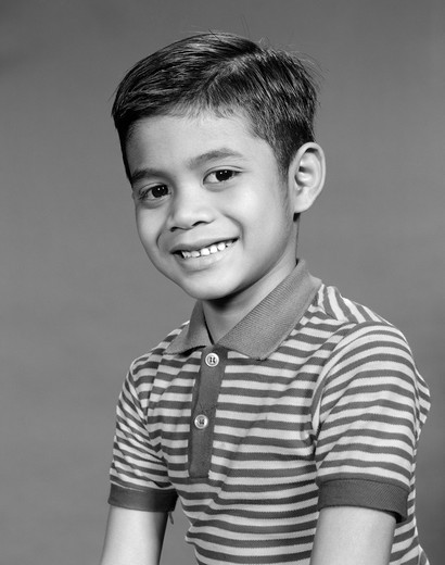 Stock Photo: 4186-1499 1950S 1960S Portrait Smiling Boy Ethnic Indonesian Indian Asian In Striped Tee Shirt