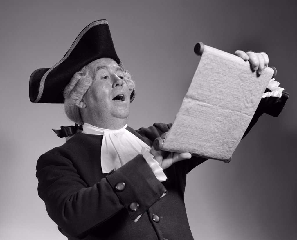 1960S 1970S Man In Colonial Town Crier Costume Reading Off Of Scroll : Stock Photo