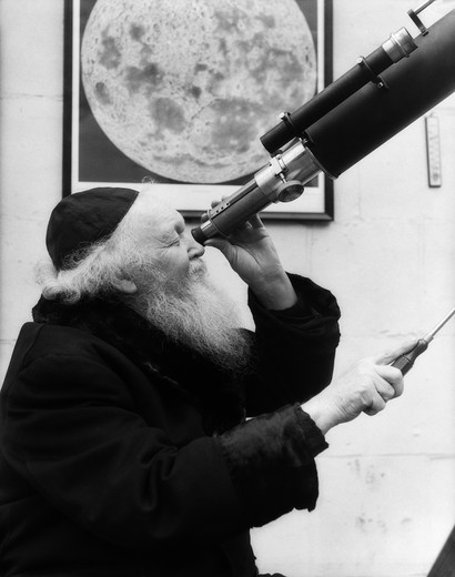 Stock Photo: 4186-1568 1930S Astronomer Looking Through Telescope