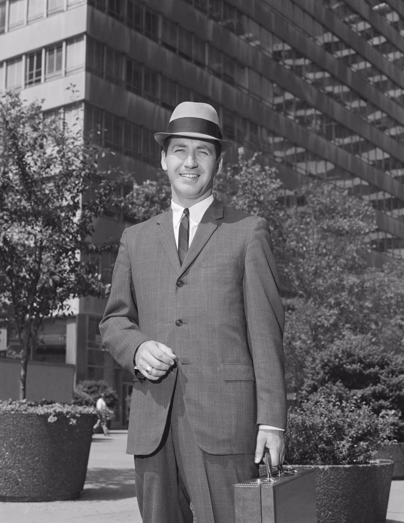 Stock Photo: 4186-15734 1960S Portrait Businessman Wearing Hat Suit Holding Briefcase