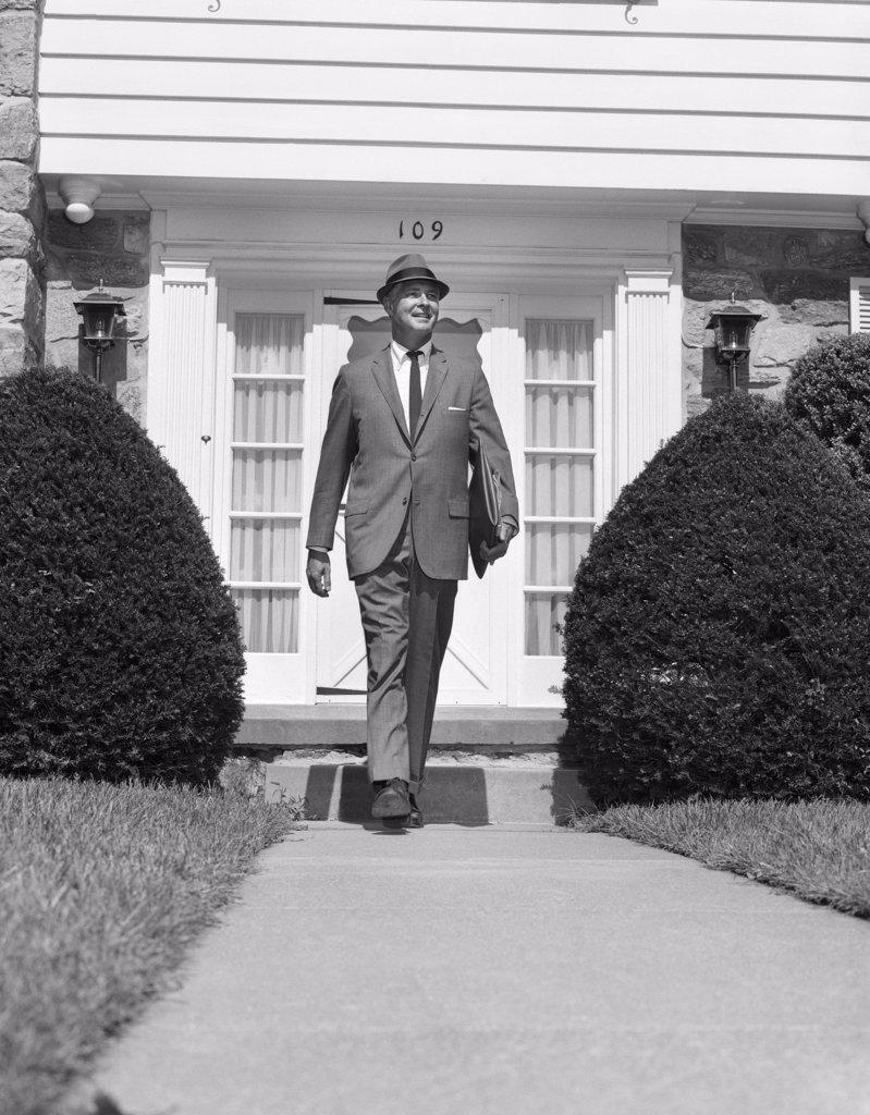 1950S Man House Sidewalk Hat Suit Walking Tie Portfolio : Stock Photo