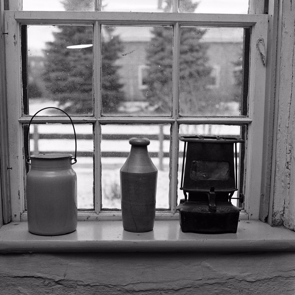 Stock Photo: 4186-15987 Still Life Of Milk Pail Pottery Bottle & Small Heater From Earlier Times