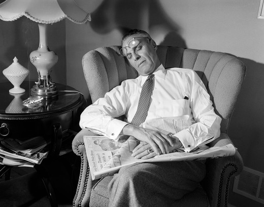 1940S Man Fell Asleep While Reading Newspaper In Chair Glasses On Forehead : Stock Photo