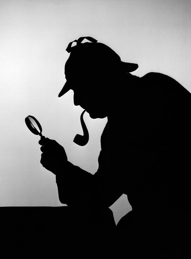 1940S Silhouette Of Sherlock Holmes Holding Magnifying Glass : Stock Photo
