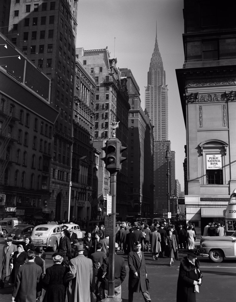 1940S Pedestrian Crowd Taxis Crossing Intersection 42Nd Street & 5Th Avenue Stop Lights Chrysler Building Nyc : Stock Photo