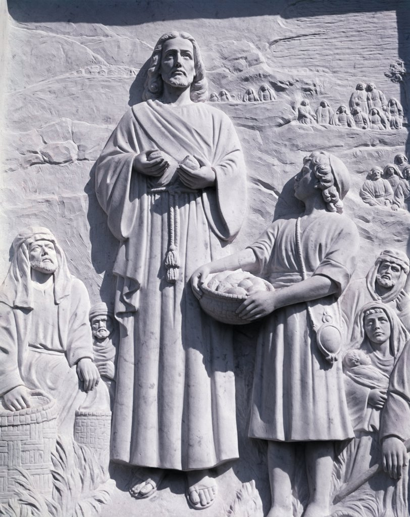 Stock Photo: 4186-17336 Bas Relief Of Jesus Breaking A Loaf Of Bread Depicting The Miracle Of Loaves And Fishes