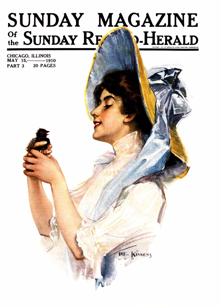 1900s 1910s SMILING WOMAN WEARING HAT TIED WITH LARGE BLUE BOW HOLDING BIRD MAY 15 1910 SUNDAY MAGAZINE COVER : Stock Photo