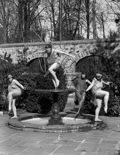 Stock Photo: 4186-1886 1920S Sprites Dancing In Fountain