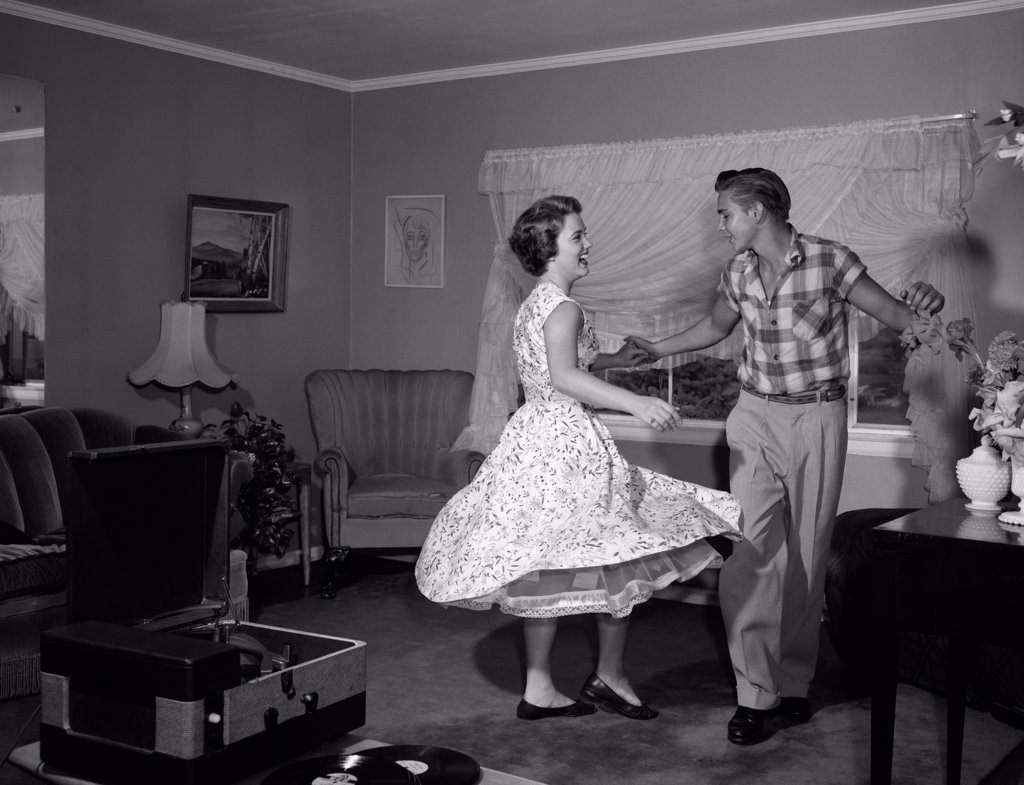 Stock Photo: 4186-2009 1950S-60S Teen Couple Dancing Jitterbug In Living Room