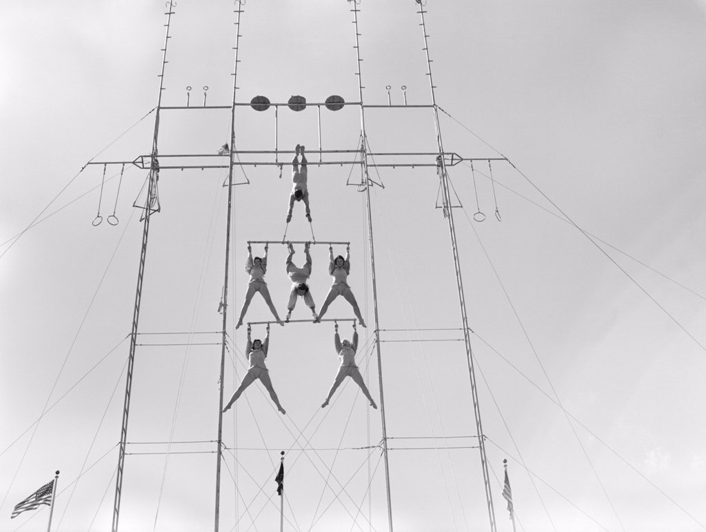Stock Photo: 4186-2094 1950S Six Circus Performers Balanced On High Trapeze
