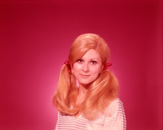 1960S Head And Shoulders Portrait Woman Hair In Pony Tails : Stock Photo