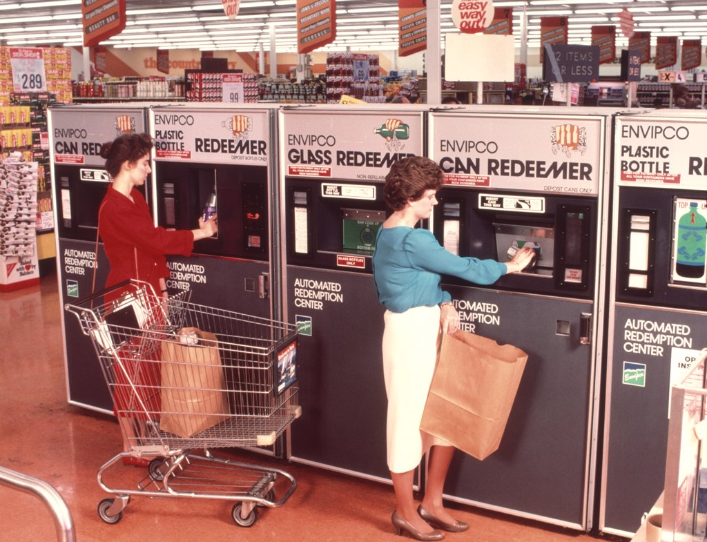 Stock Photo: 4186-2342 1970S Women Redeeming Deposit On Cans & Bottles At Supermarket Redemption Center