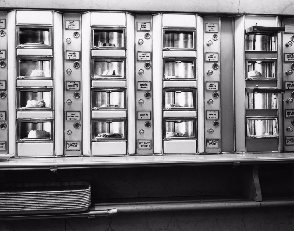 Stock Photo: 4186-2392 1960S Series Automat Cafeteria Vending Machine Windows Containing Cake And Pie Desserts
