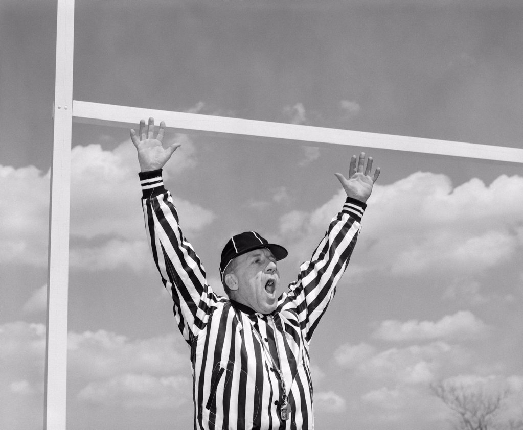 1960S American Football Referee Making Touchdown Hand Signal At Goal Post  : Stock Photo