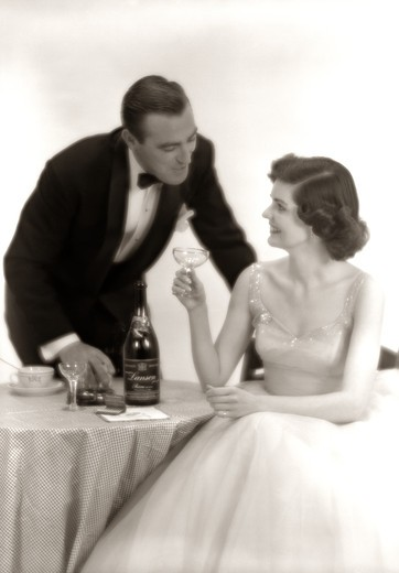Stock Photo: 4186-2702 1950S Formal Dress Couple Man In Tuxedo Woman Wearing Gown Holding Champagne Glass