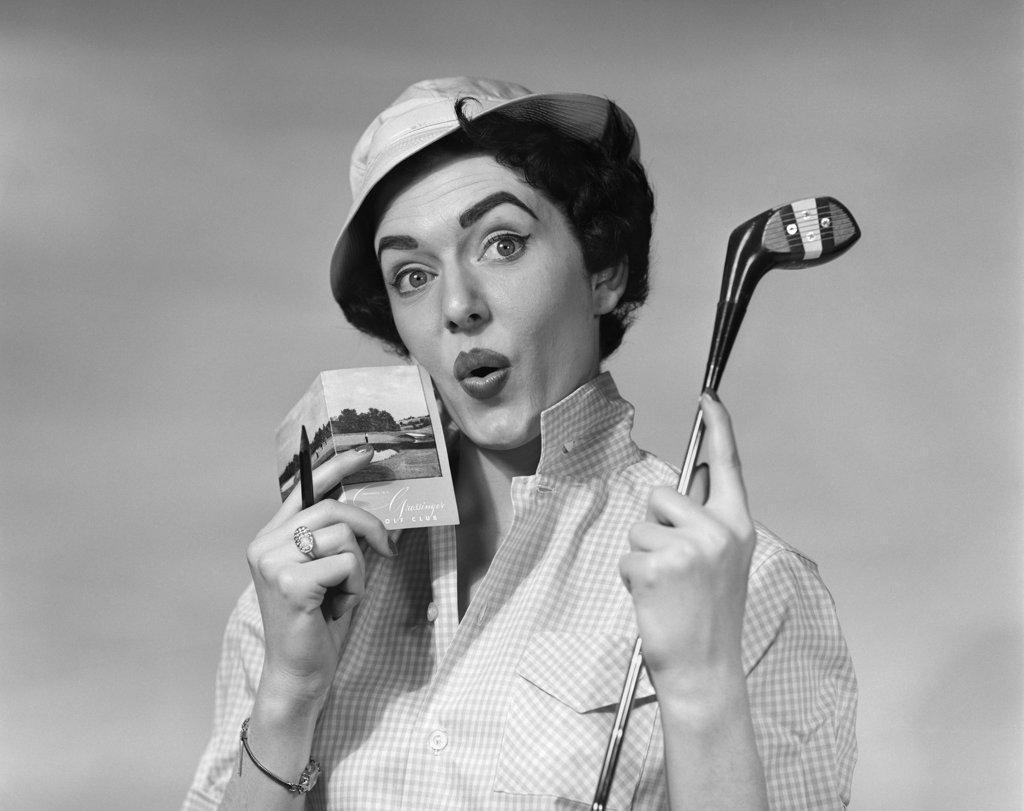 Stock Photo: 4186-2825 1950S Woman Holding Golf Club Driver And Score Card & Pencil In Other Hand Par Worried Expression Wearing Hat And Checked Blouse