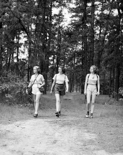 Stock Photo: 4186-3283 1940S Three Young Women Walking In Woods Hiking