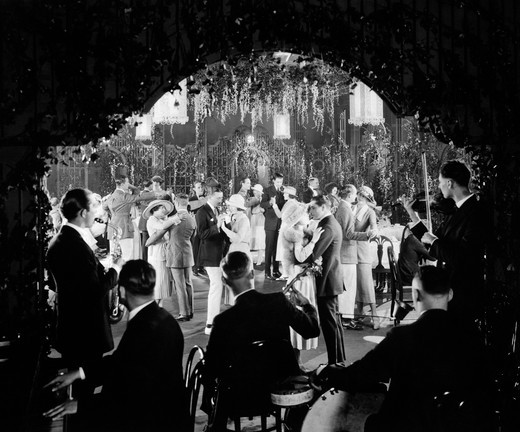 1920S Movie Still Couples Dancing Ballroom View From Over Shoulders Of Band Musicians : Stock Photo
