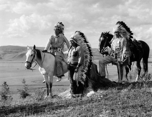 1930S Trio Of Stoney Indians With Pair Of Horses On Reservation Looking Outward : Stock Photo