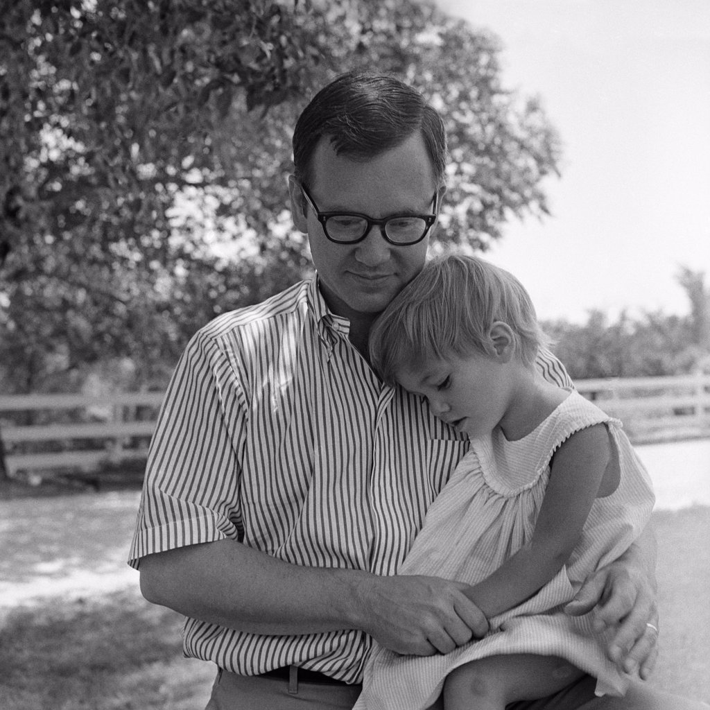 1970S Father Sitting Outside With Daughter On Knee Comforting Her : Stock Photo