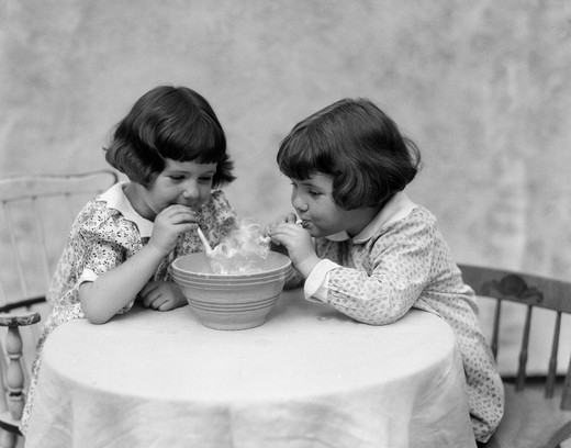 1930S Two Girls Playing Blowing Soap Bubble Pipes : Stock Photo