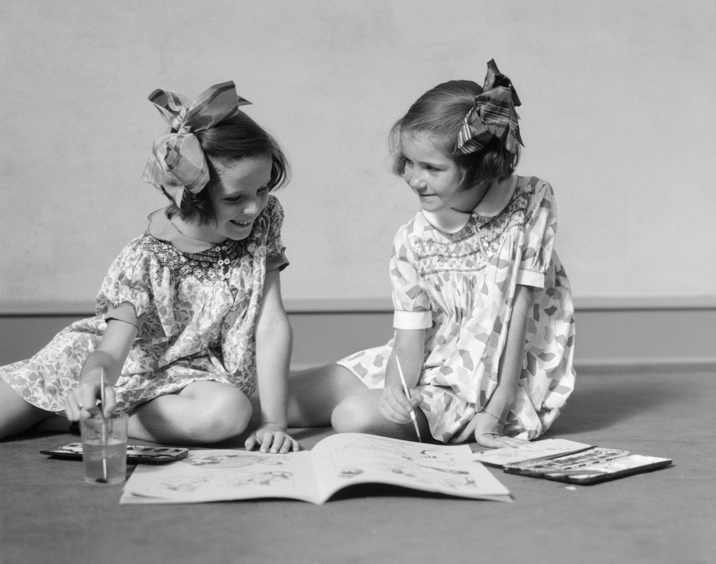 Stock Photo: 4186-3936 1930S Two Girls Painting In Book With Watercolors