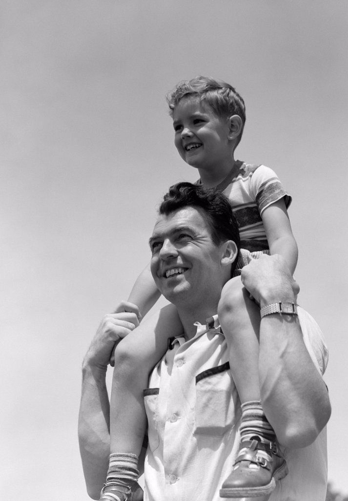 Stock Photo: 4186-4004 1950S Smiling Father Carrying Son On Shoulders Outdoor